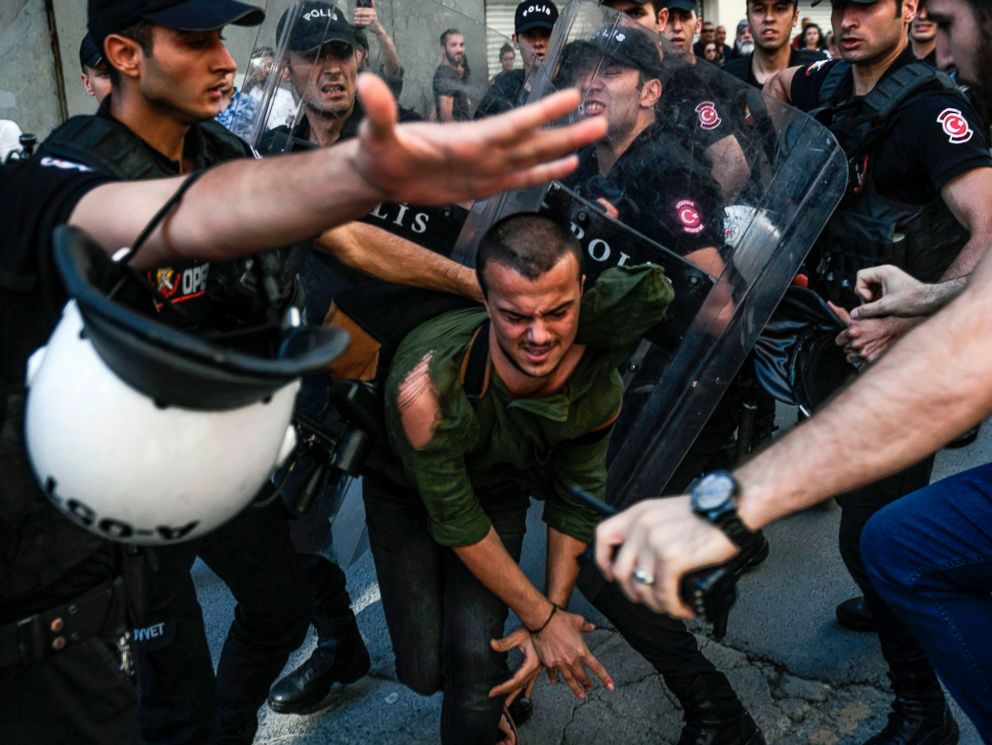 PHOTO: A plain-clothes police officer kicks a member of a group of LGBT rights activist as Turkish police prevent them from going ahead with a Gay Pride annual parade on June 25, 2017 in Istanbul, a day after it was banned by the city governors office.
