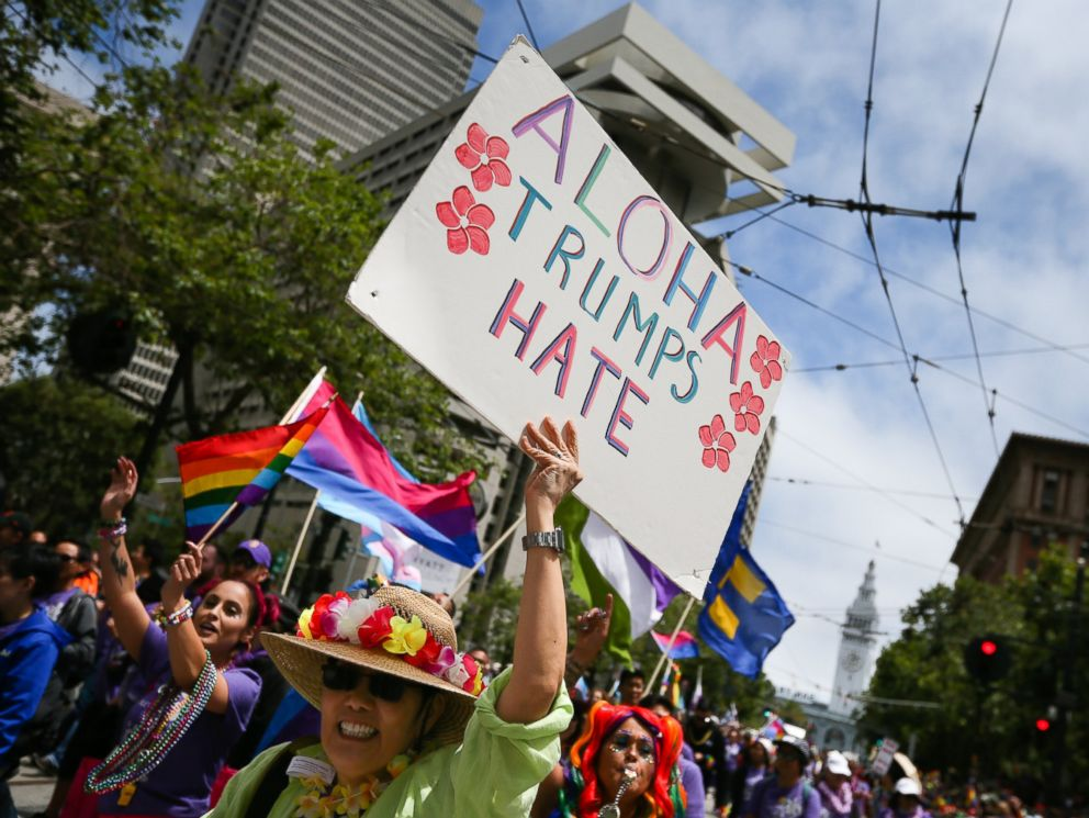 PHOTO: A woman holds a sign saying Aloha Trumps Hate while participating in the annual LGBTQI Pride Parade, June 25, 2017 in San Francisco. The LGBT community descended on Market Street for the 47th annual Pride Parade.