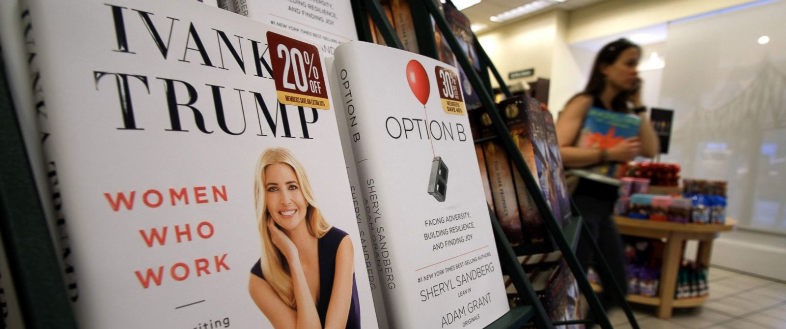 "PHOTO: A woman walks past a shelf displaying Ivanka Trumps book ""Women Who Work: Rewriting the Rules for Success"" at a Barnes and Noble bookstore in New York, May 2, 2017."