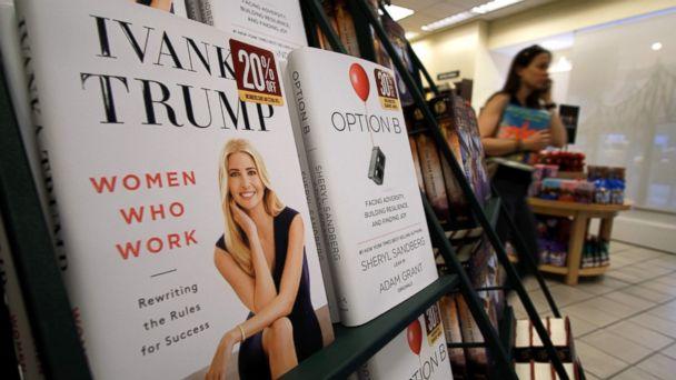 PHOTO: A woman walks past a shelf displaying Ivanka Trump's book