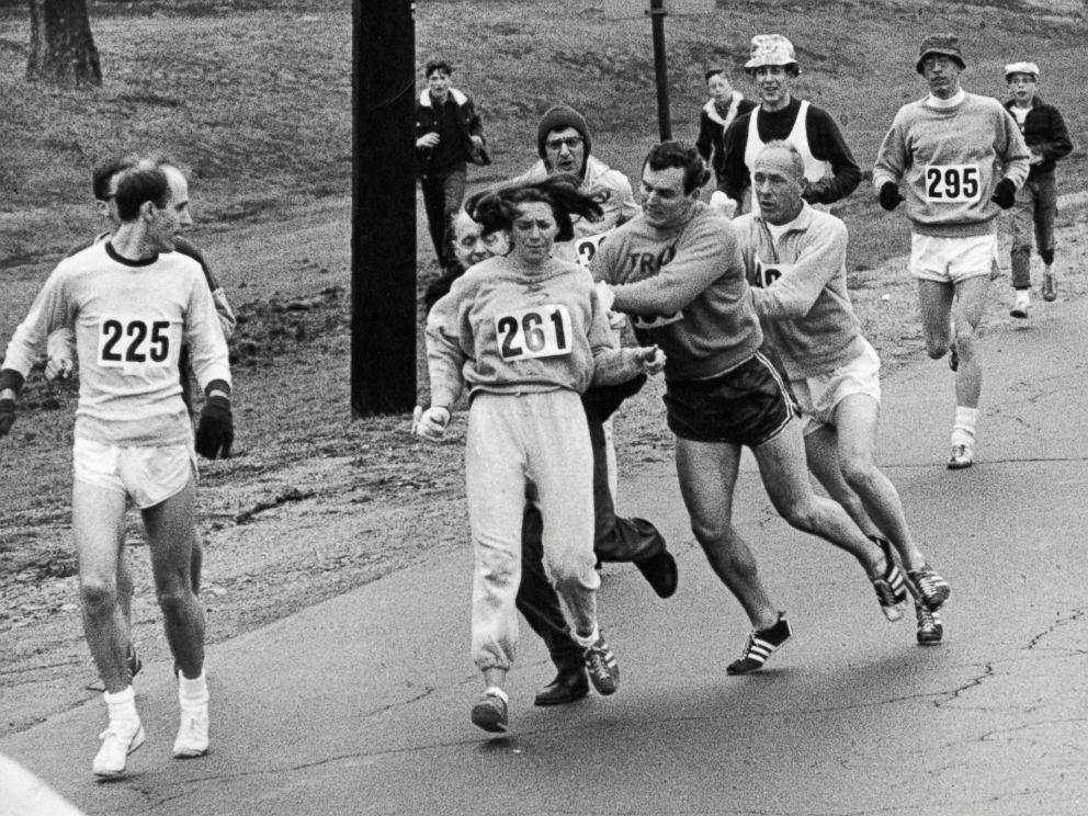 PHOTO: Kathrine Switzer, center, was spotted early in the Boston Marathon by Jock Semple, center right, who tried to rip the number off her shirt and remove her from the race, April 19, 1967.