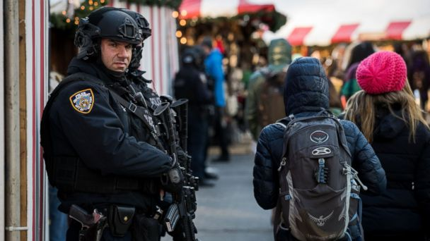 PHOTO: Heavily armed New York City Police officers stand guard at the Columbus Circle Holiday Market, Dec. 20, 2016 in New York City.