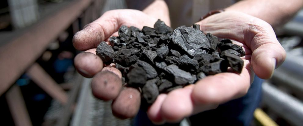 "PHOTO: A KFx company executive shows off a handful of the companys K-Fuel or ""clean coal,"" an upgraded coal produced with nearby Powder River Basin, June 12, 2006, in Gillette, Wyoming."