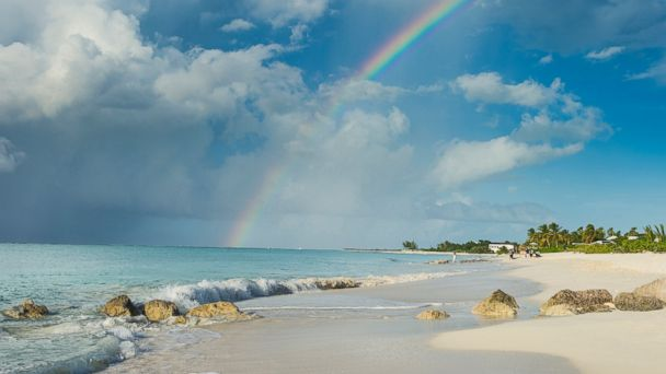 PHOTO: A rainbow is pictured over Grace Bay beach in Providenciales, Turks and Caicos in this undated stock photo.
