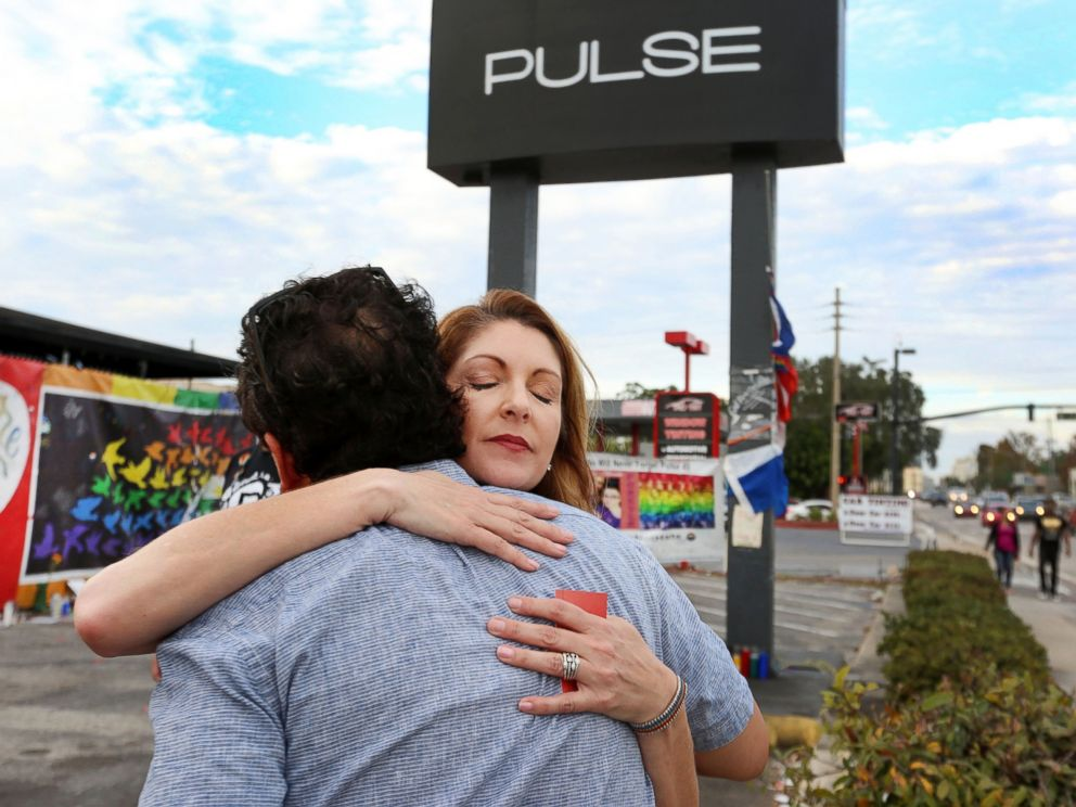 PHOTO: Barbara Poma, right, the owner of the Pulse Nightclub, is hugged, Dec. 5, 2016, in front of the club after a press conference.