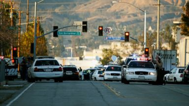 PHOTO: Law enforcement officers close Mountain View Avenue during the pursuit of suspects in the shooting at the Inland Regional Center, Dec. 2, 2015, in San Bernardino, California.