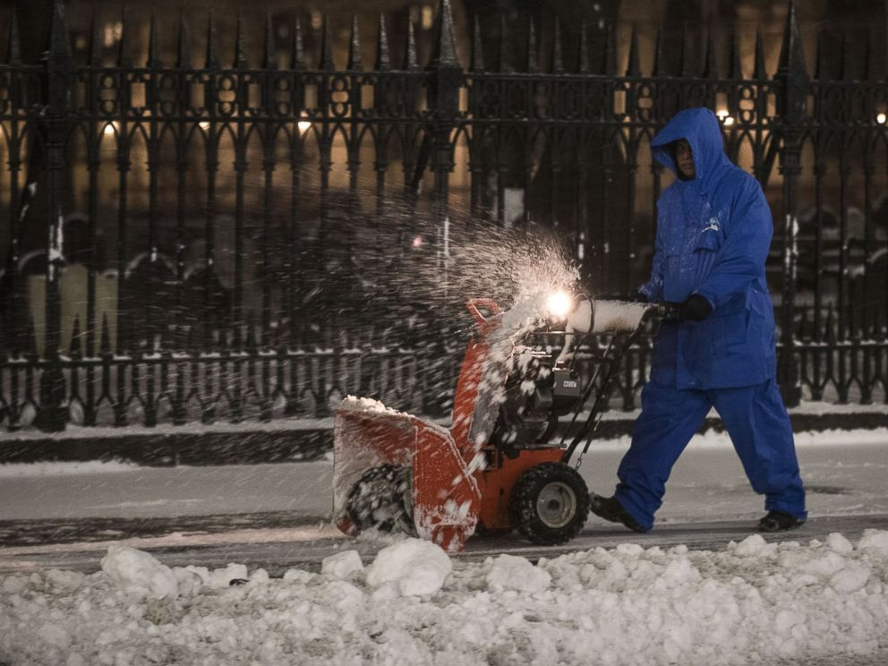 PHOTO: A worker clears snow in the early morning hours in the Financial District, March 14, 2017, in N.Y.