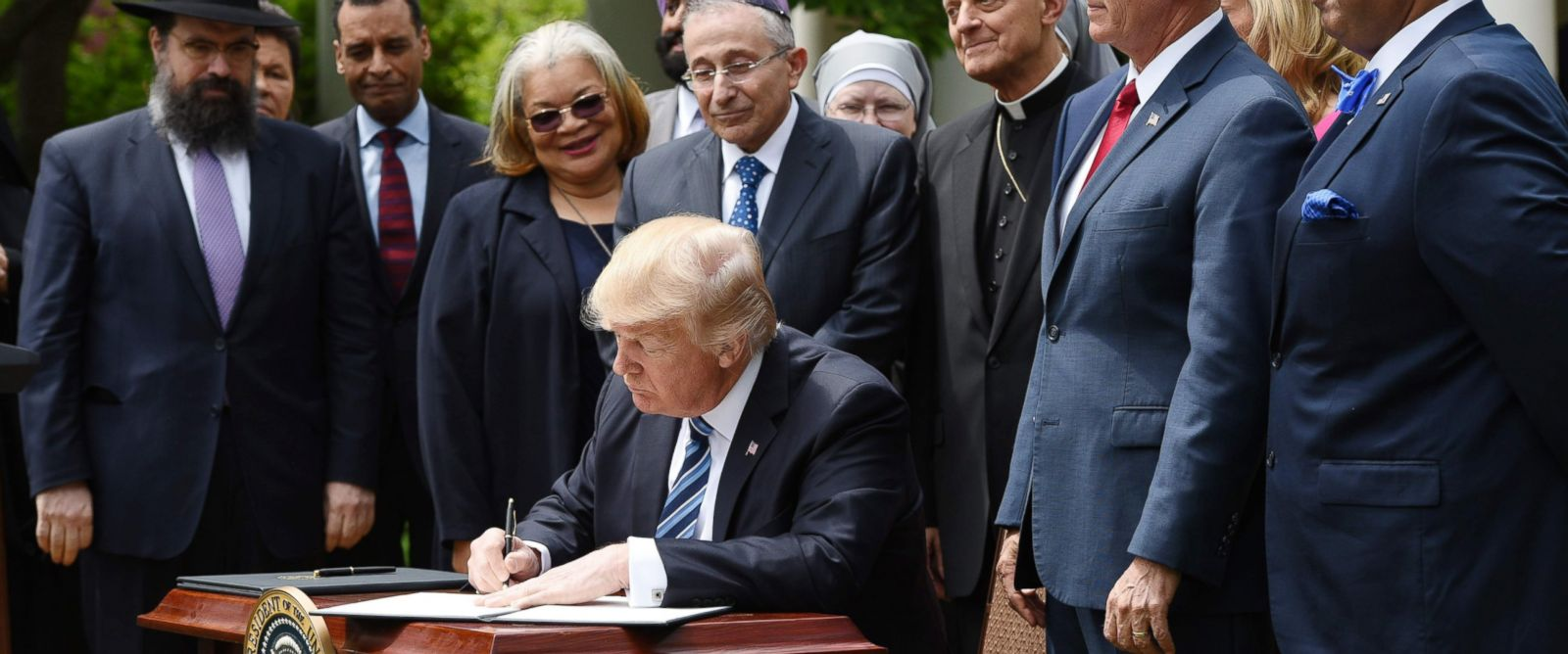 PHOTO: President Donald Trump signs an Executive Order on Promoting Free Speech and Religious Liberty in the Rose Garden of the White House, May 4, 2017, Washington.