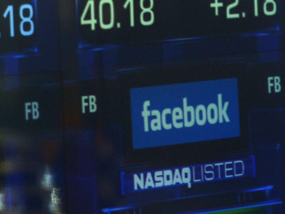 PHOTO: Screens display the start of trading in Facebook shares at the NASDAQ stock exchange in Times Square in New York, May 18, 2012.