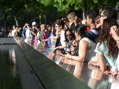 PHOTO: Tourists are pictured visiting the National 9/11 Memorial Museum in New York City on May 25, 2014.