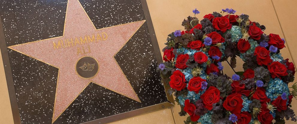 PHOTO: Flowers are placed at Muhammad Alis star on the Hollywood Walk of Fame on June 4, 2016 in Hollywood, California. Sports legend Muhammad Ali died June 3rd at the age of 74.