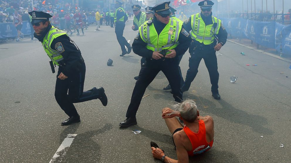 PHOTO: Boston police officers respond to a bombing at the finish line of the 2013 Boston Marathon, April 15, 2013, in Boston.