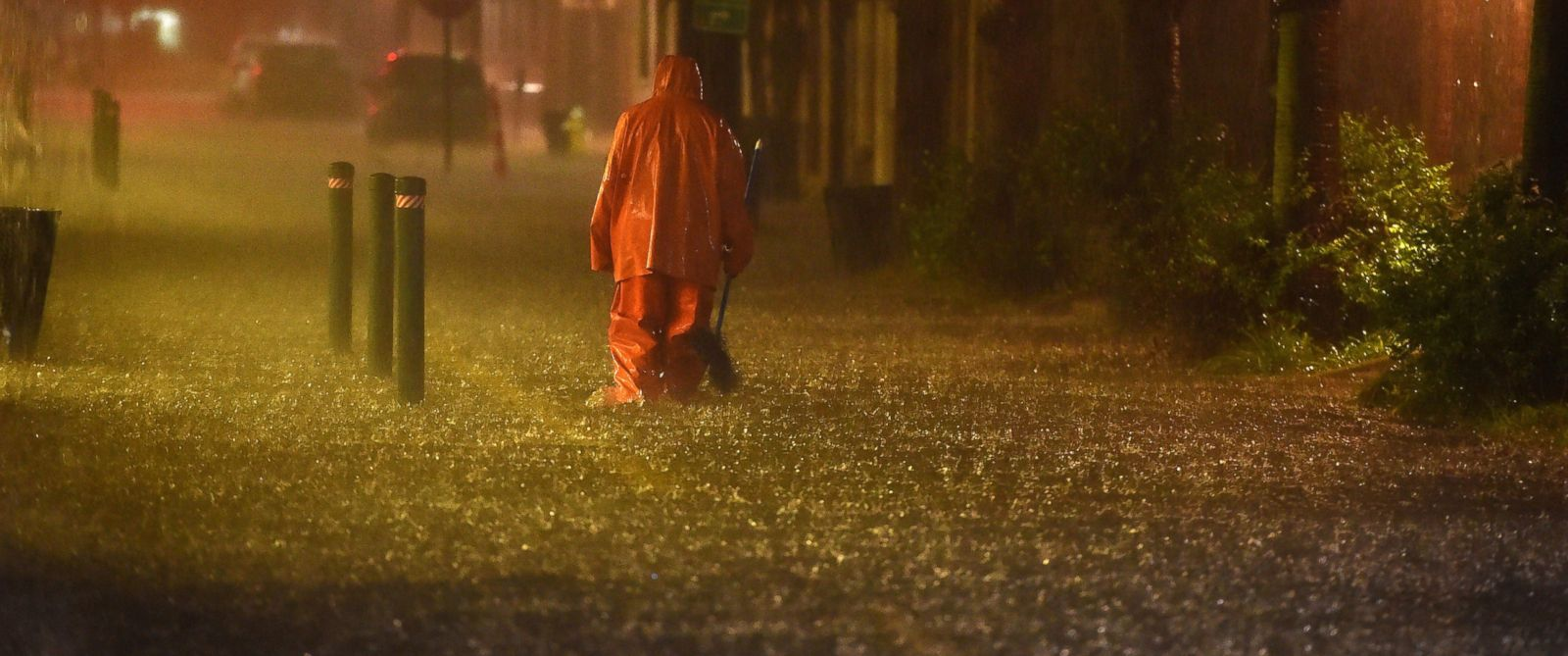 PHOTO: A communal worker walks at a flooded street in downtown Charleston, SC on October 03, 2015.