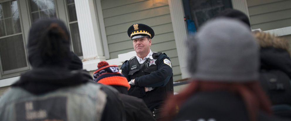 PHOTO: Protestors confront police guarding Mayor Rahm Emanuels home on Dec. 29, 2015 in Chicago.