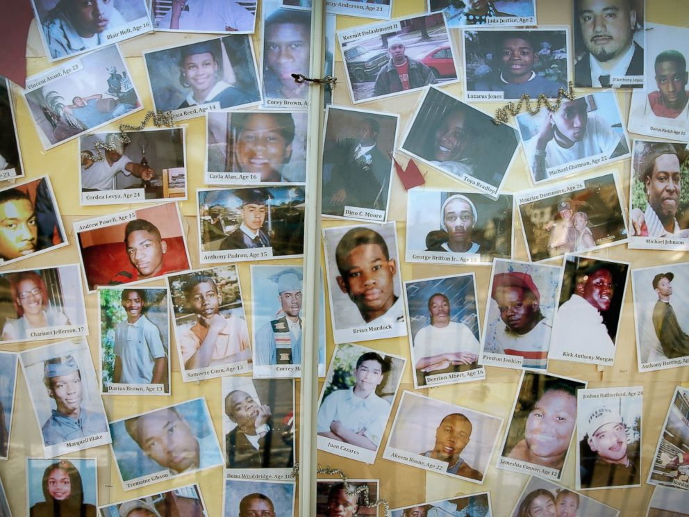 PHOTO: CHICAGO, IL - DECEMBER 23: Pictures of Chicago residents who have died by gunfire are posted next to a Christmas tree outside Saint Sabina Church in the Auburn Gresham neighborhood on the citys Southside on December 23, 2013 in Chicago, Illinois.