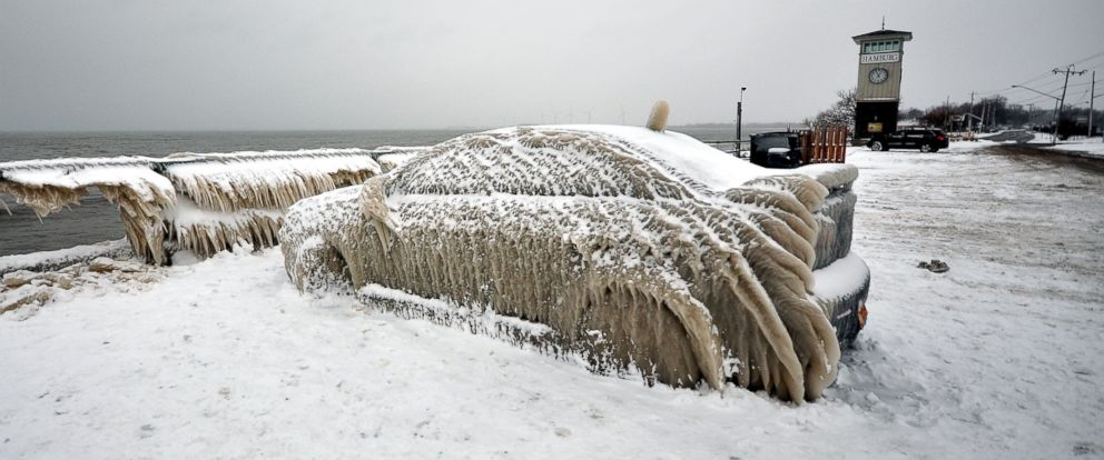 PHOTO: A car is covered in ice after being left in a parking lot on the shore of Lake Erie in Hamburg, New York, Jan. 2, 2016.