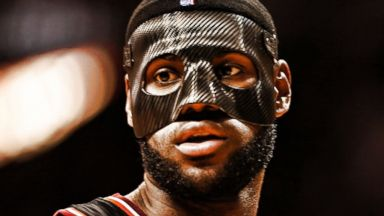 PHOTO: LeBron James #6 of the Miami Heat wears a mask to begin the game against the New York Knicks at American Airlines Arena, Feb. 27, 2014 in Miami.