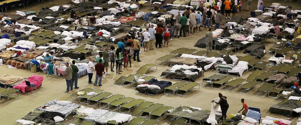 PHOTO: Evacuees take advantage of the shelter setup in the The Baton Rouge River Center arena as the area deals with the record flooding that took place causing thousands of people to seek temporary shelters, on Aug. 19, 2016, in Baton Rouge.
