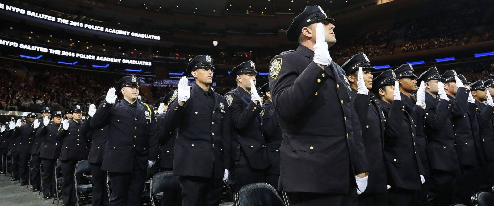 PHOTO: New members of New York Citys police departments graduating class participate in a swearing in ceremony at Madison Square Garden on July 1, 2016 in New York City.
