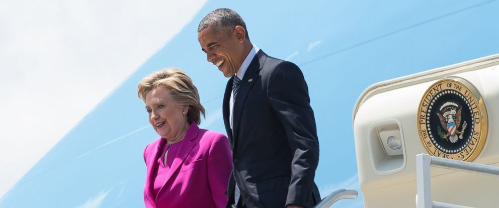 PHOTO: Barack Obama and Democratic presidential candidate Hillary Clinton walk off Air Force One in Charlotte, N.C., to attend a campaign event.
