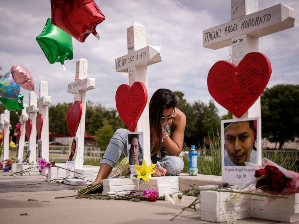 PHOTO:A woman writes a note on a cross for Eric Ivan Ortiz-Rivera at a memorial with wooden crosses for each of the 49 victims of the Pulse Nightclub, next to the Orlando Regional Medical Center, June 17, 2016 in Orlando, Fla.