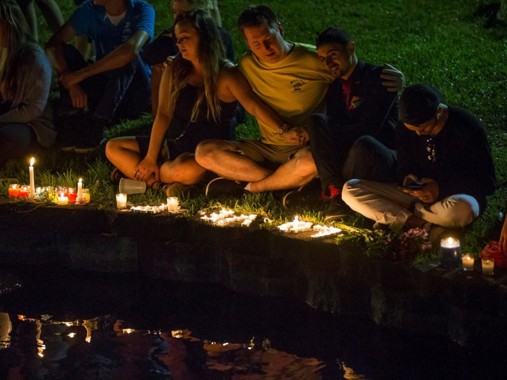 PHOTO: Mourners gather at Lake Eola for a candle light vigil for the victims of the terrorist massacre at the Pulse night club in Orlando on June 12, 2016.