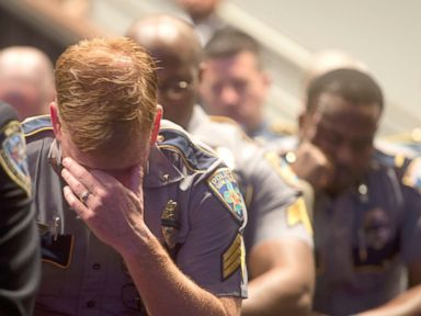 PHOTO: A police officer bows his head during funeral services for Baton Rouge police officer Matthew Gerald at the Healing Place Church, July 22, 2016, in Baton Rouge, Louisiana.