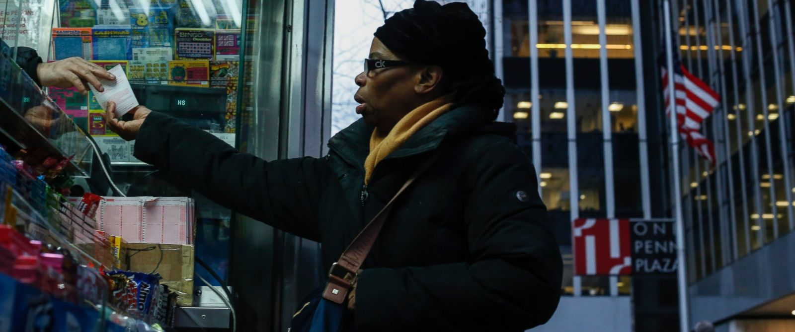 PHOTO:A woman buys a Powerball lottery ticket at a newsstand in New York City, Jan. 12, 2016.