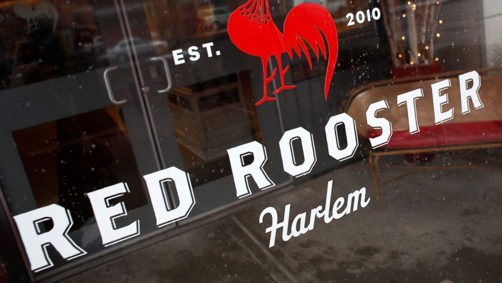 PHOTO: A general view of Red Rooster as celebrity chef Marcus Samuelsson speaks with guests at the restaurant on December 10, 2013 in New York City.
