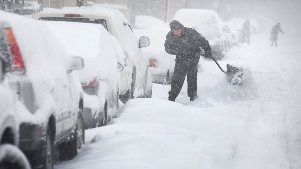 PHOTO: A man digs out his car along a snow-covered street on February 1, 2015 in Chicago, Illinois.