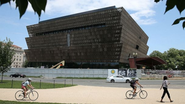 PHOTO: Tourist's walk past the Smithsonian Museum of African American History and Culture that is currently under construction, July 16, 2015 in Washington.