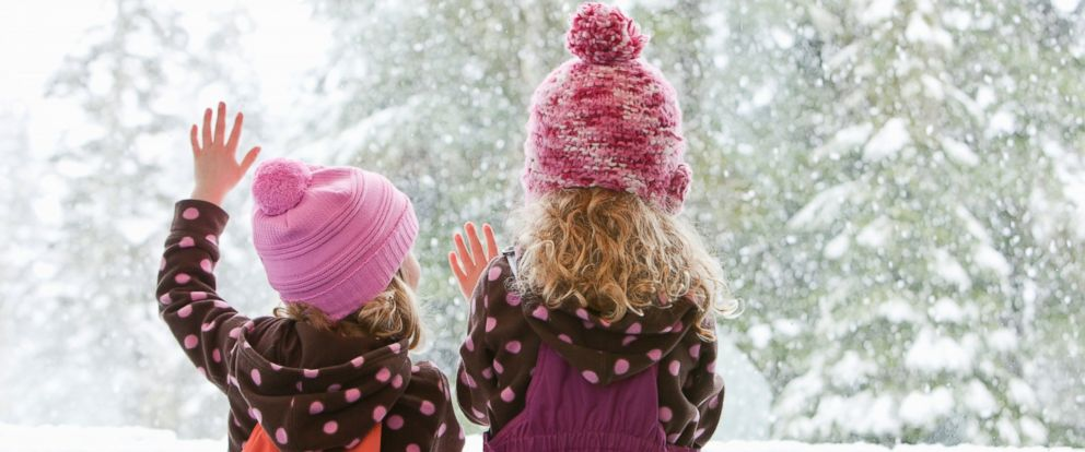 PHOTO: An undated stock photo of young girls watching the snowfall outside.
