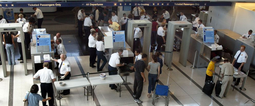 PHOTO: TSA agents shown working in Terminal 5/International Departures at OHare International Airport August 6, 2002 in Chicago, Illinois.