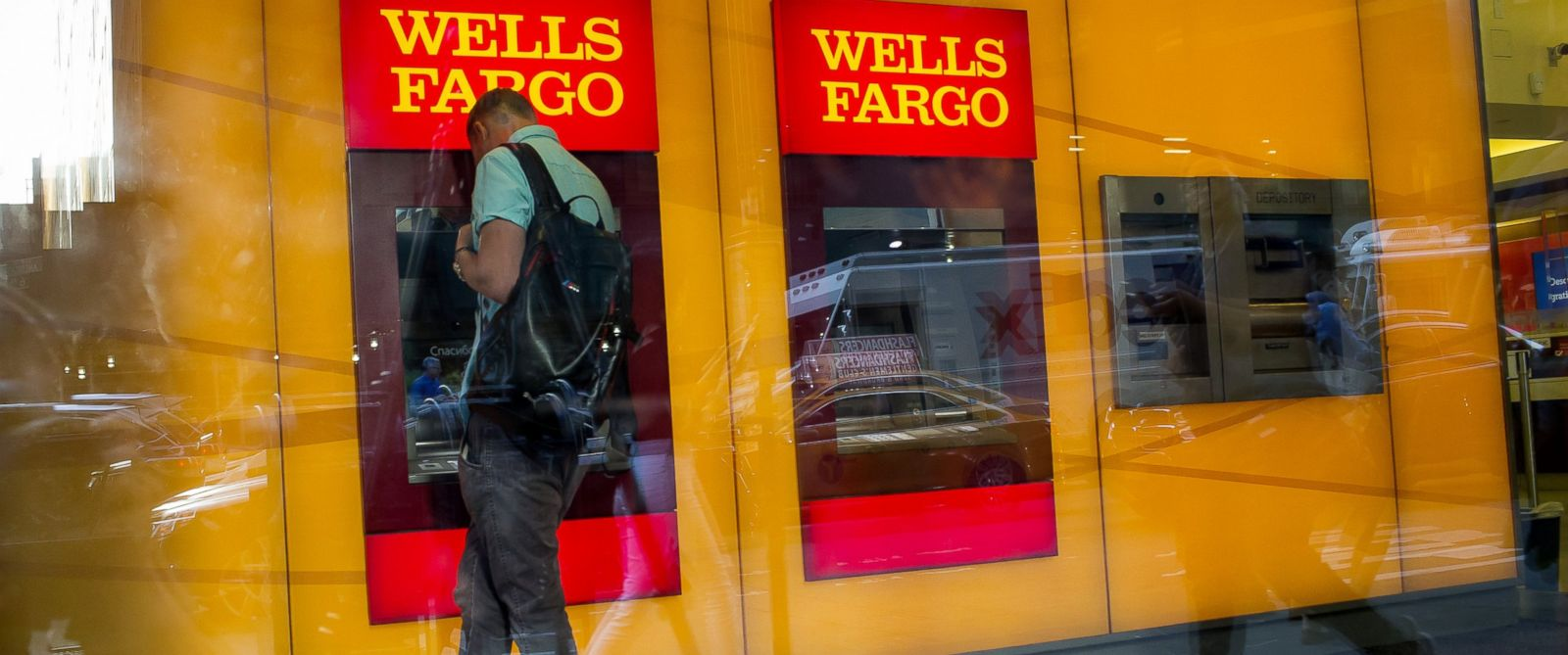 PHOTO:A man uses a Wells Fargo ATM inside a bank branch in New York, July 12, 2016.