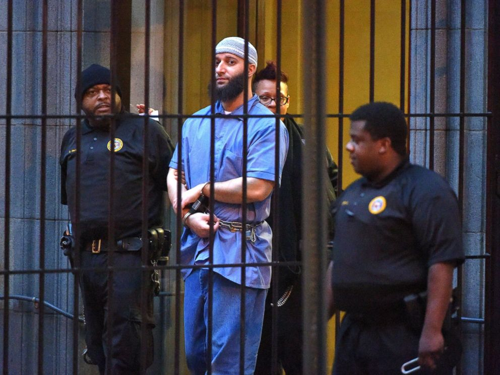 PHOTO:Officials escort Serial podcast subject Adnan Syed from the courthouse following the completion of the first day of hearings for a retrial in Baltimore, Feb. 3, 2016.