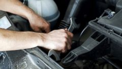 PHOTO: An auto mechanic fixes a car in this stock image.