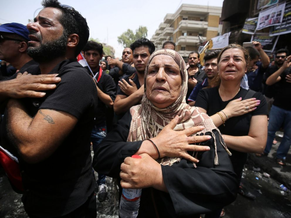 PHOTO: Iraqis beat themselves on the chest on July 6, 2016, as they mourn the victims of a suicide bombing that ripped through Baghdads busy shopping district of Karrada on July 3.