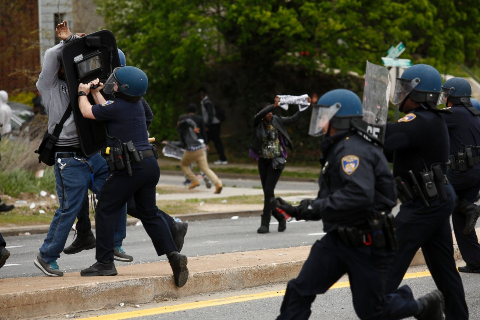 Baltimore police officers in riot gear push protestors back along - Baltimore Police Officers In Riot Gear Push Protestors Back Along 10