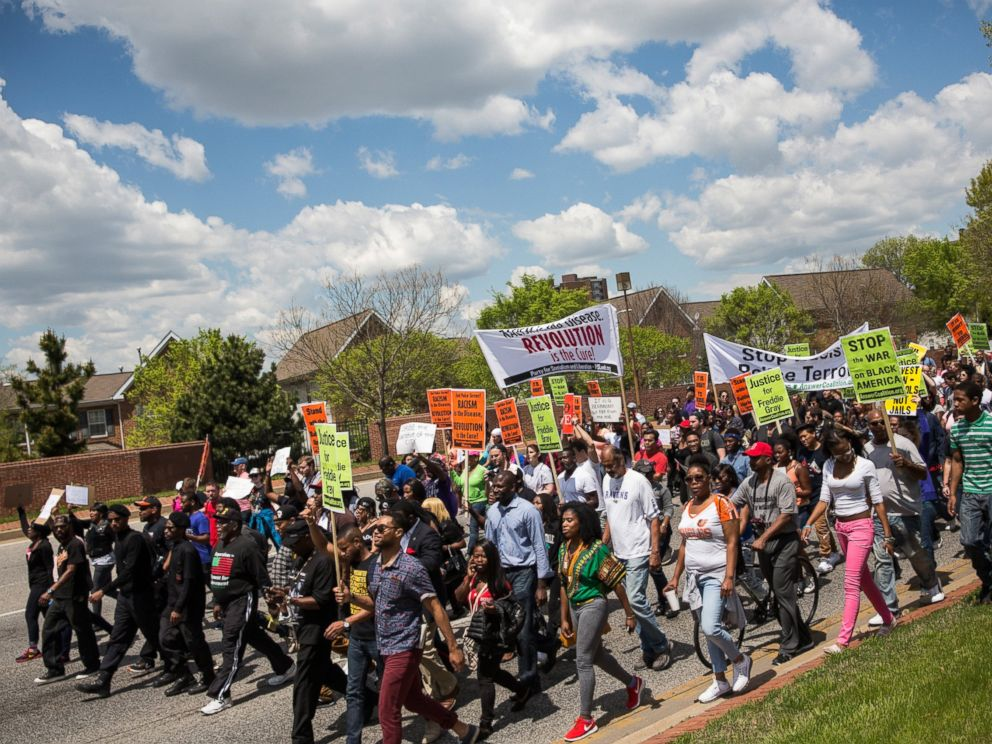 PHOTO: Protesters march from the Gilmor Homes, where Freddie Gray was arrested, to City Hall on May 2, 2015 in Baltimore, Md.