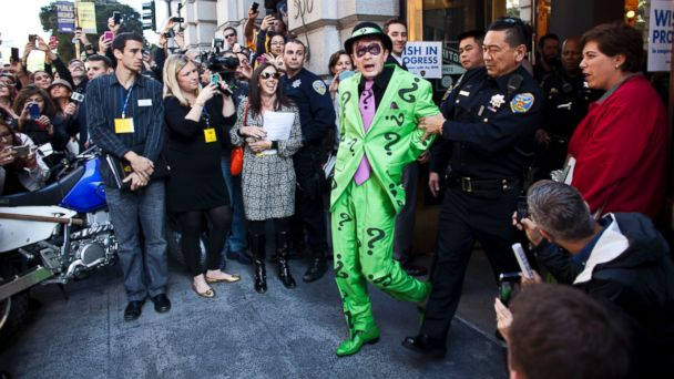 PHOTO: San Francisco police officers arrest the Riddler with the help of leukemia survivor Miles