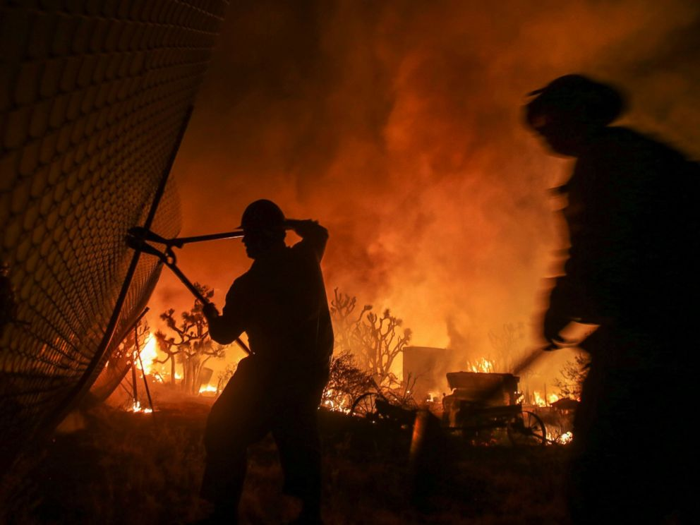 PHOTO: Firefighters battle the Blue Cut wildfire near Cajon Pass, north of San Bernardino, California, Aug. 16, 2016.