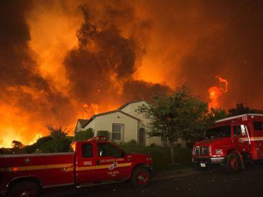 PHOTO: Flames close in on homes at the Sand Fire, July 23 2016 near Santa Clarita, California.