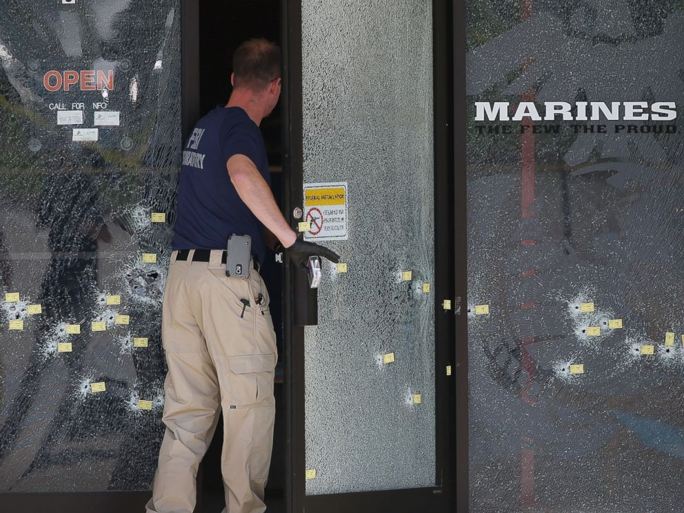 PHOTO: A member of the F.B.I. Evidence Response Team walks through a bullet riddled door as he investigates the shooting at the Armed Forces Career Center/National Guard Recruitment Office, July 17, 2015 in Chattanooga, Tennessee.