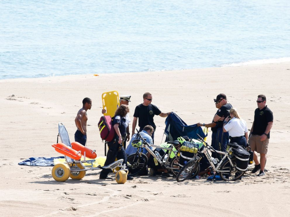 PHOTO: A Navy Leap Frog parachuter receives medical attention on North Avenue Beach on Aug. 15, 2015, after a performance at the first day of the annual Chicago Air & Water Show in Chicago.