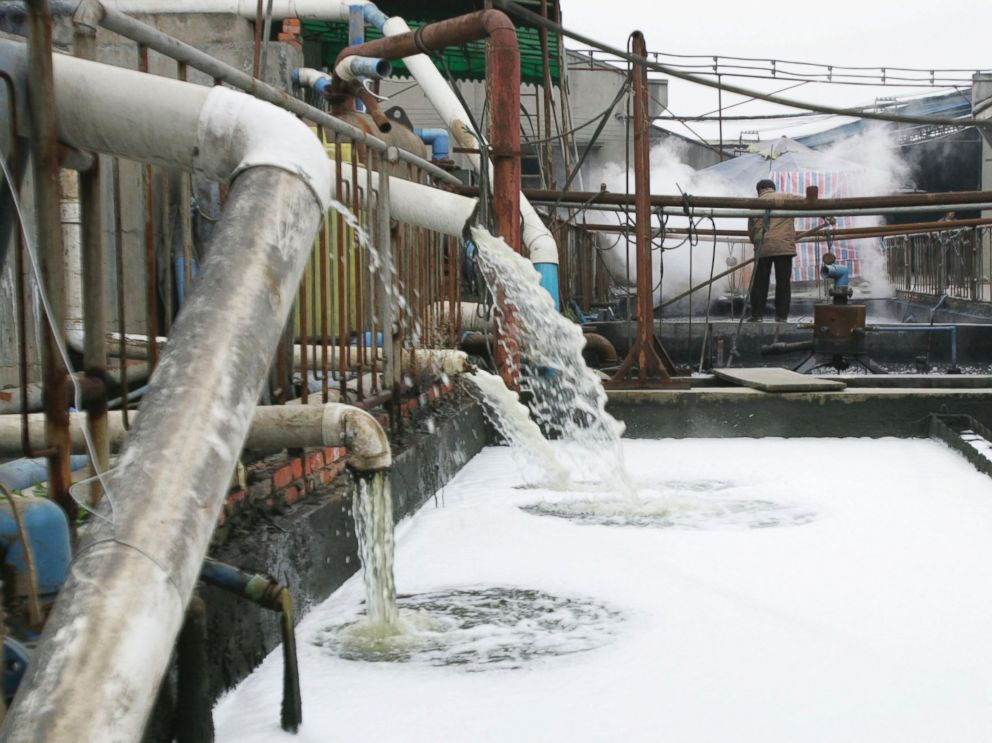 PHOTO: Pipes emit waste water into a wastewater treatment pond at a garments factory, Dec. 5, 2005 in Chengdu of Sichuan Province, China.