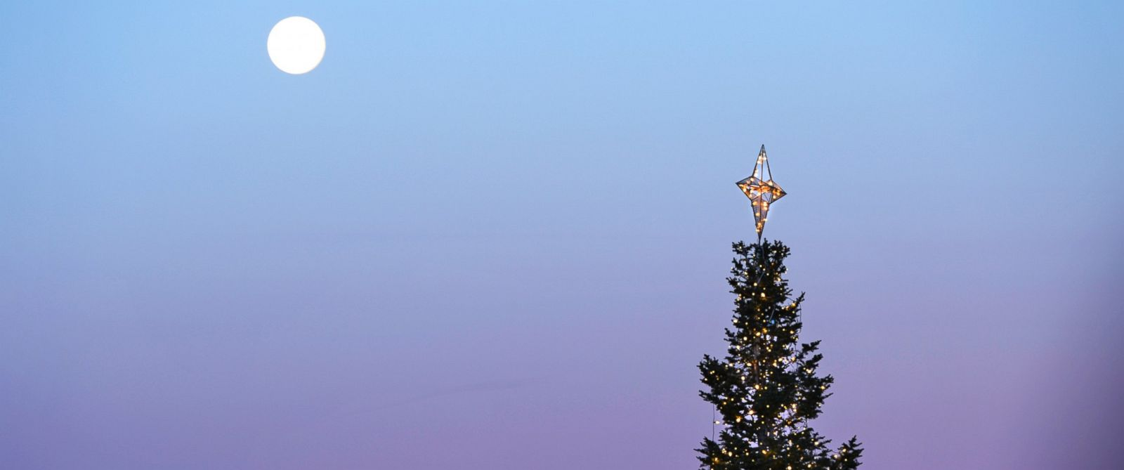 PHOTO: A full moon is seen over a Christmas tree in Centennial Center Park, Centenniel, Colorado on Dec. 18, 2013.