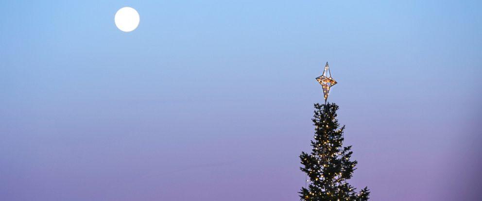 PHOTO: A full moon is seen over a Christmas tree in Centennial Center Park, Centenniel, Colorado on Dec. 18, 2013.