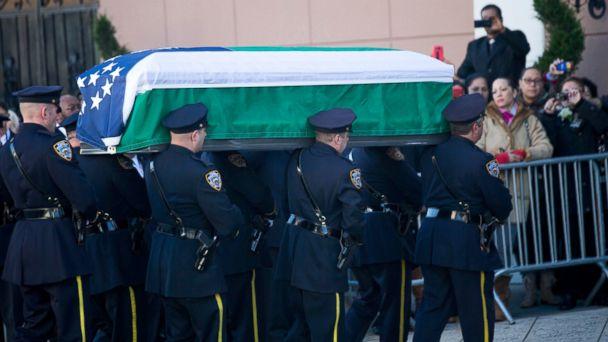 http://a.abcnews.com/images/US/GTY_cop_funeral_jef_141226_16x9_608.jpg