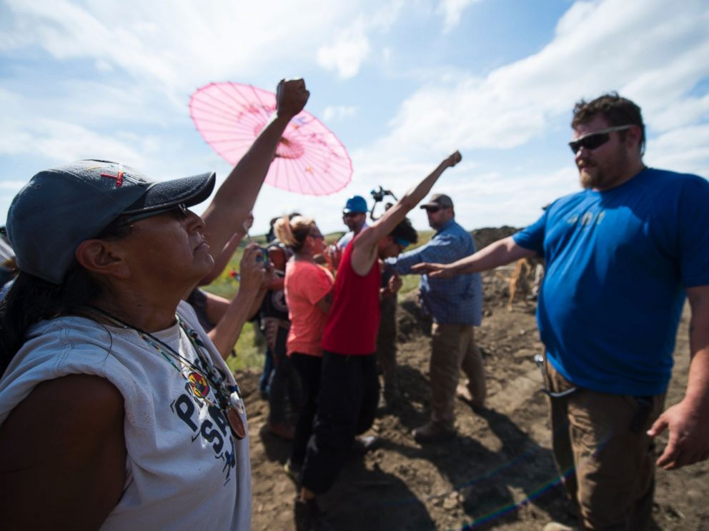 PHOTO: Security agents, right, confront protestors on the worksite for the Dakota Access Pipeline (DAPL) oil pipeline, near Cannonball, North Dakota, Sept. 3, 2016.