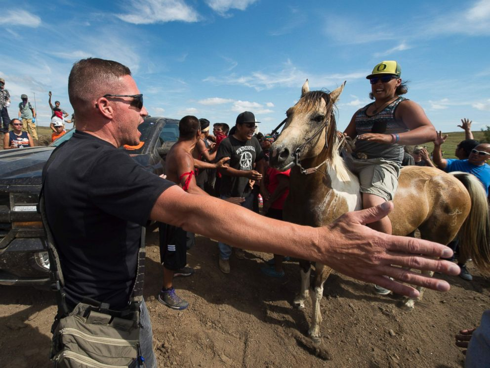 PHOTO: Native American protestors and their supporters are confronted by security during a demonstration against work being done for the Dakota Access Pipeline (DAPL) oil pipeline, near Cannonball, North Dakota, Sept. 3, 2016.
